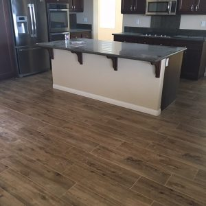 Hardwood floor with compliment floor and surrounding | Direct Carpet Unlimited
