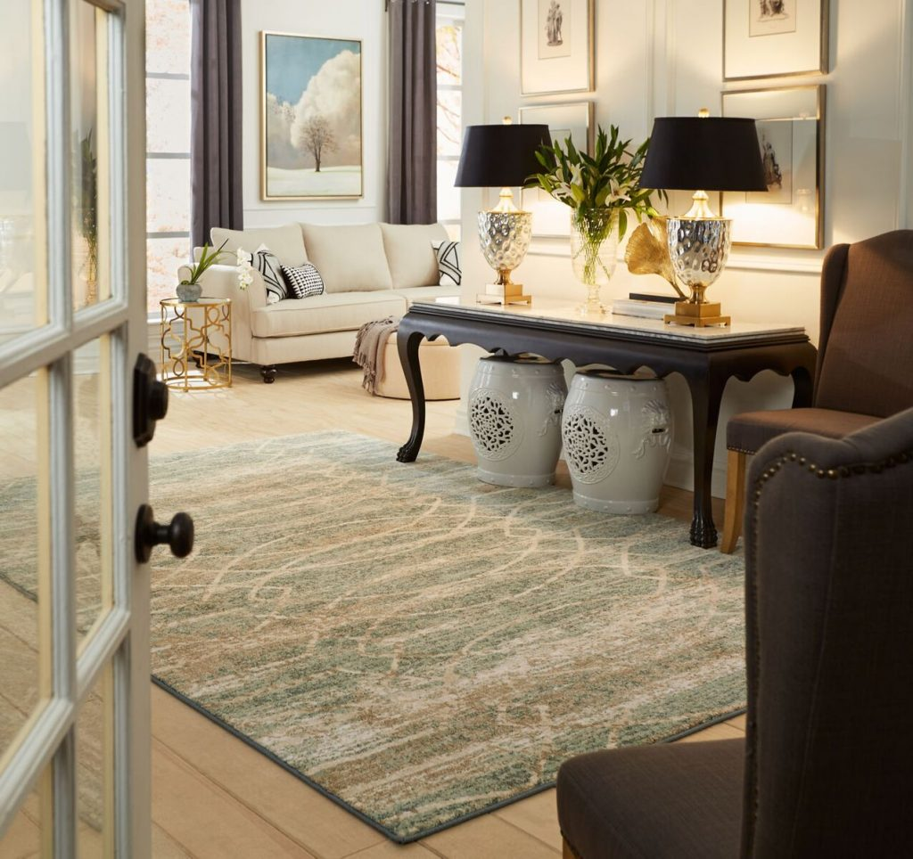 Stunning Area Rug layered over carpet | Direct Carpet Unlimited