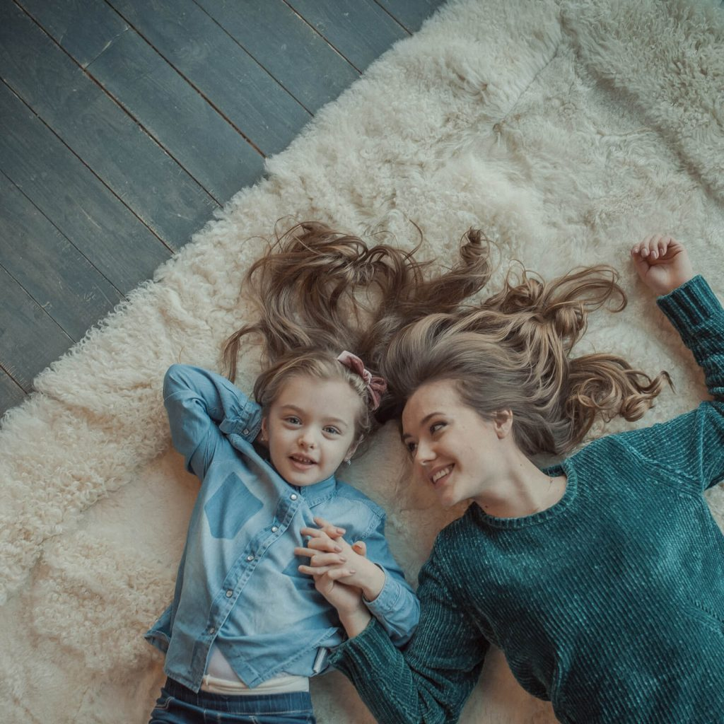 Kid with mom on Carpet | Direct Carpet Unlimited