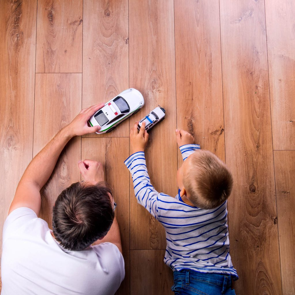 Father and kid playing with toycar | Direct Carpet Unlimited