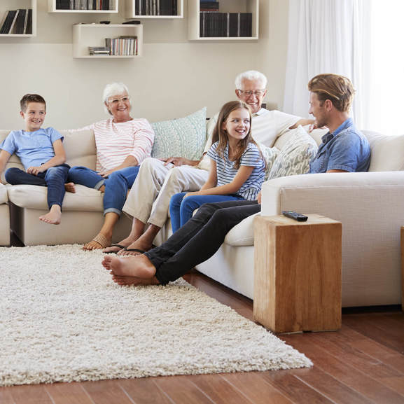 Family gosping in living room | Direct Carpet Unlimited