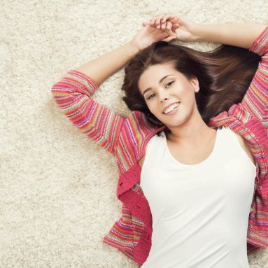 Girl laying on sofa | Direct Carpet Unlimited