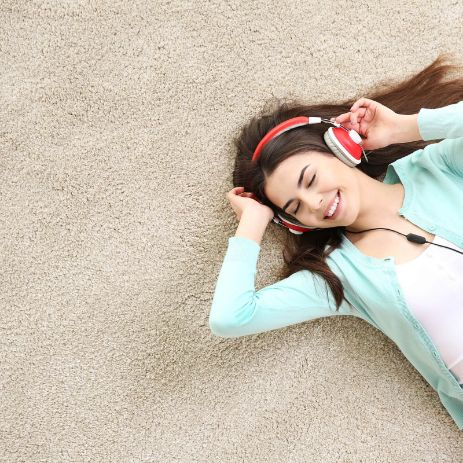 Girl listening music on Carpet | Direct Carpet Unlimited