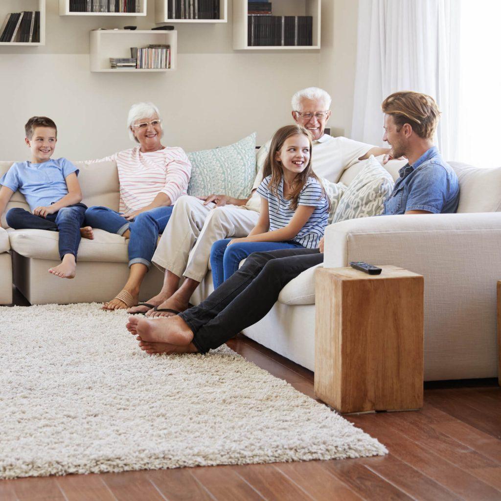 Family enjoying in living room | Direct Carpet Unlimited